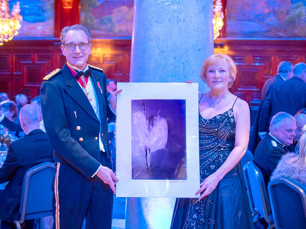"""Photo: Artwork by Dmitry Savchenko with title """" Flying Angel """", actress Natalia de Froberville, has been selected and was presented by Anna Angelina Josephine von Bach at wonderful Wiener Ball 2020. Stockholm. Sweden. Photo by Chris Schuf."""